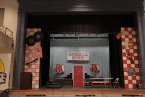 Levels with Rydell High sign and Boosters for Grease.